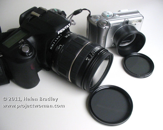 Image showing a polarizing filter for a dslr and one for a point and shoot which uses a tele converter to mount it